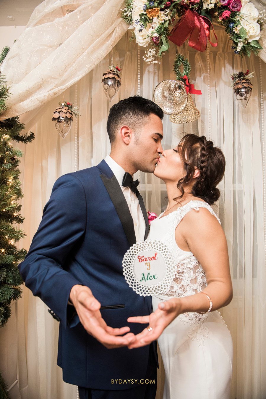 bride and groom under Christmas wedding decor