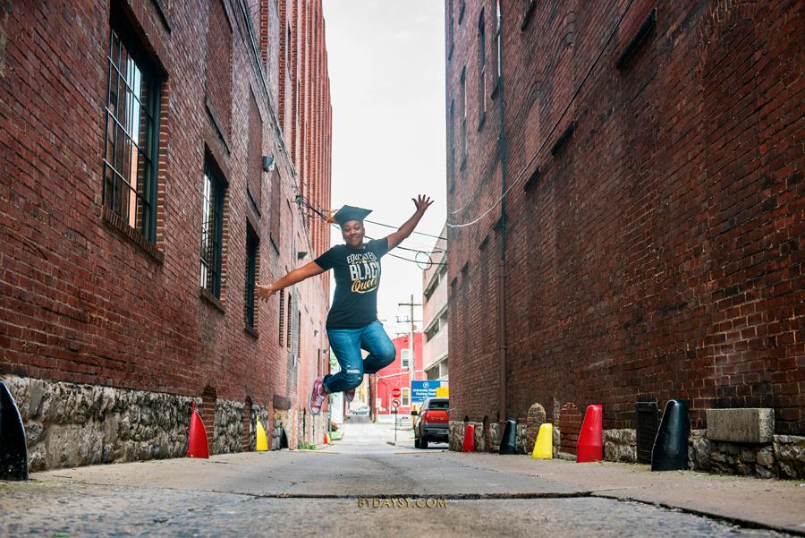 graduation photo student jumping of joy