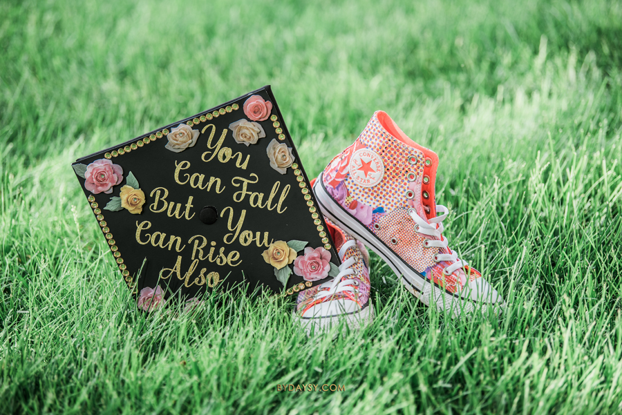 graduation cap with converse all stars shoes on grass