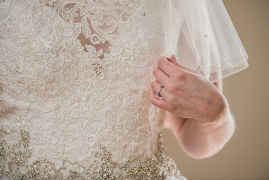 wedding ring close to wedding dress