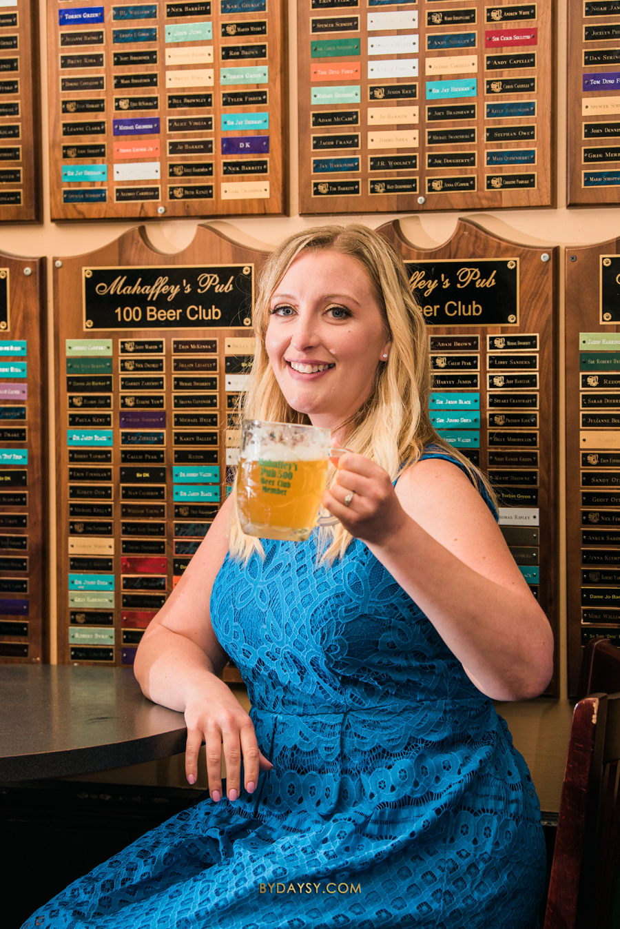 bride to be holding beer mug