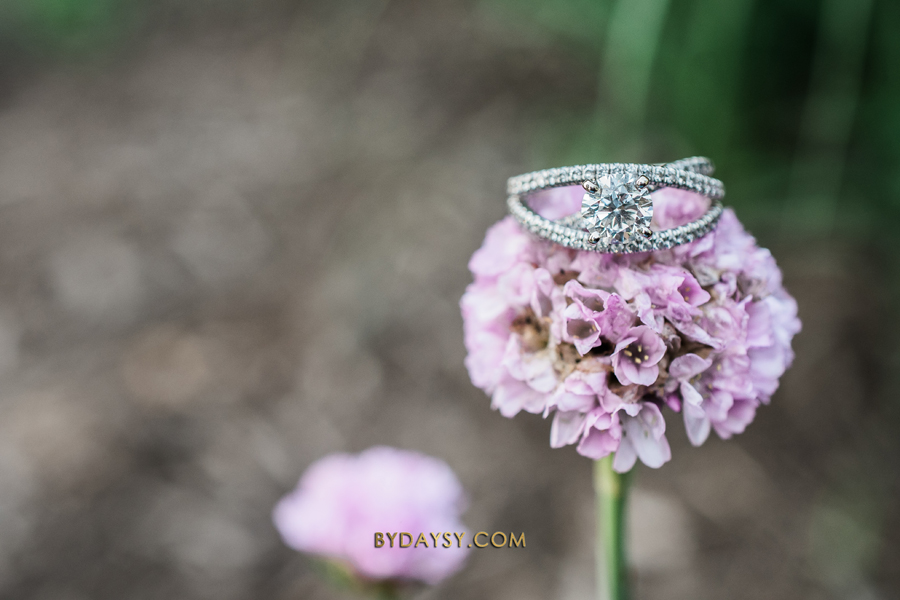 close up of engagement ring in a purple flower