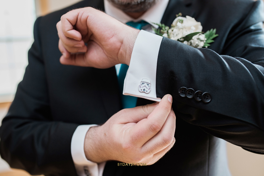 groom showing star wars cufflink