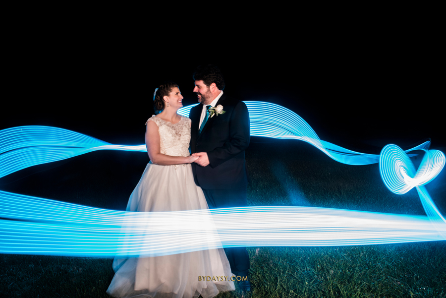 couple looking at each other with blue light paint