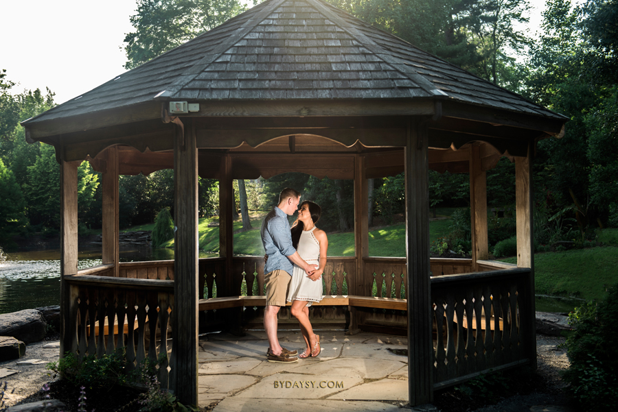 couple looking to each other in a gazebo at green spring gardens park alexandria VA