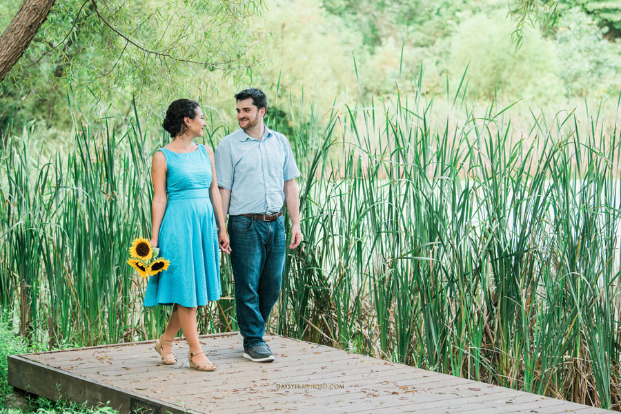 couple at Rust Nature Sanctuary bride to be holding sunflowers