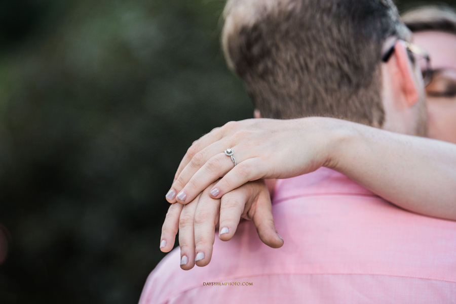 couple kissing each other with ring on close up at baker park in maryland