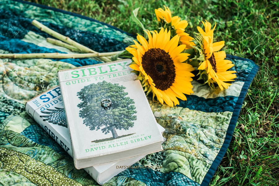 engagement ring books and sunflowers at Rust Nature Sanctuary