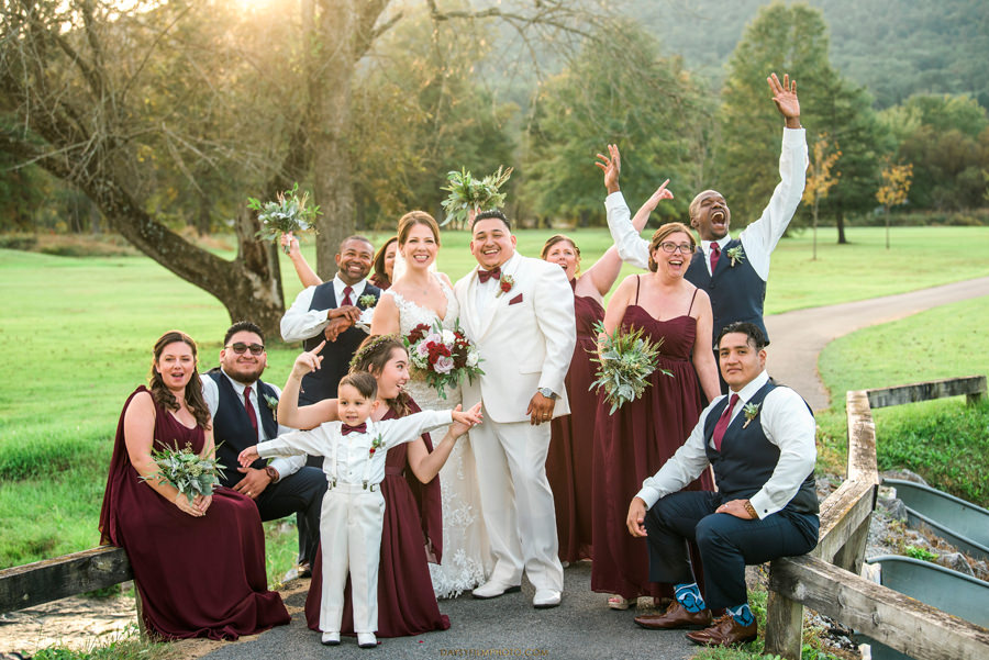 bridal party cheering up for bride and groom at liberty moutain resort