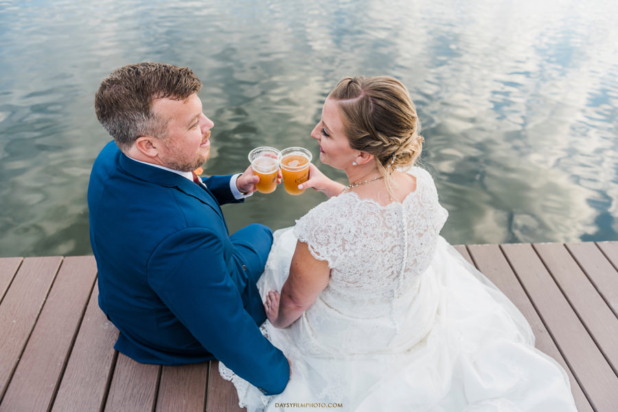 bride and groom drinking beer
