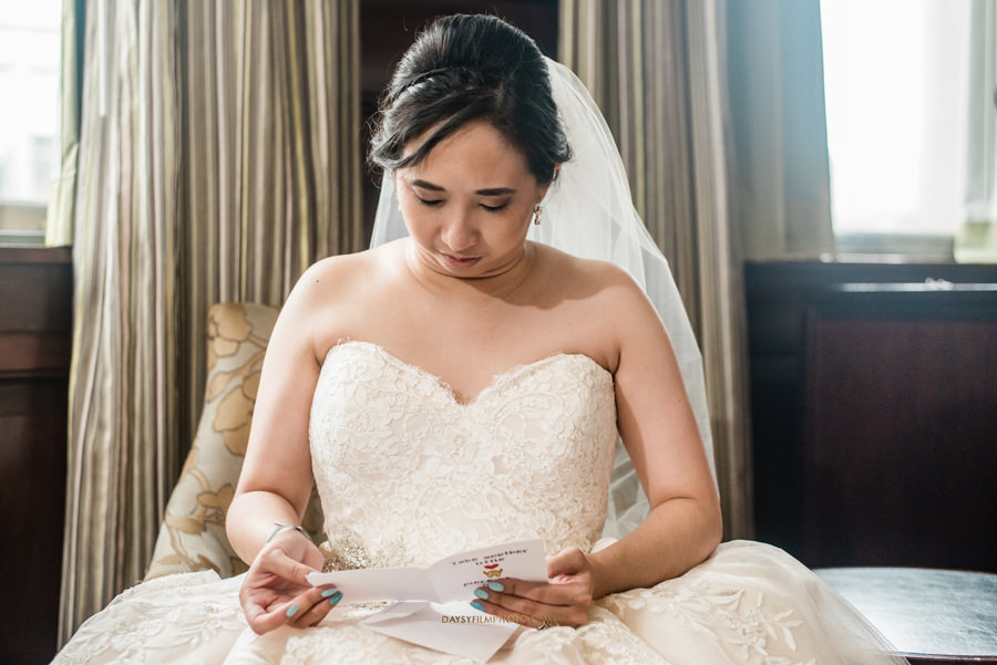 bride reading before wedding at The Mansion at the Valley Country Club