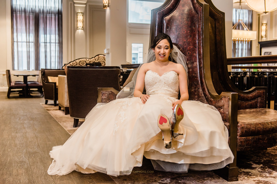 bride seating on a big chair before the wedding at The Mansion at the Valley Country Club