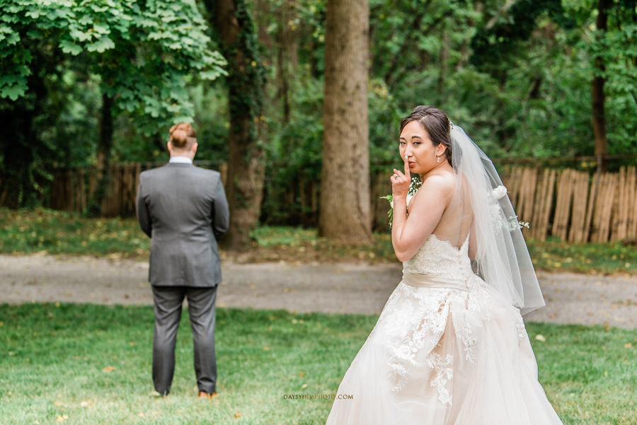bride right before the first look with groom on the back waiting for her The Mansion at the Valley Country Club