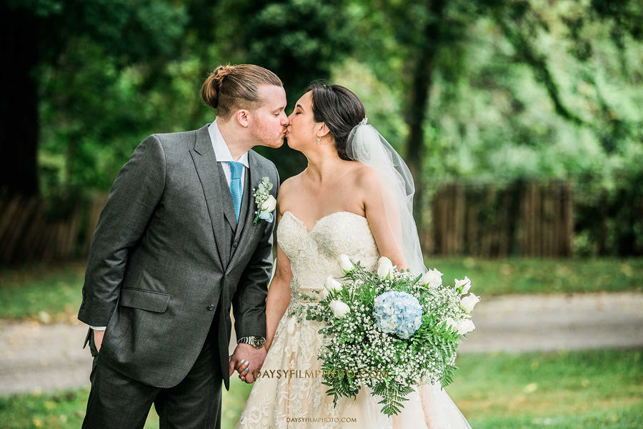 couple kissing at The Mansion at the Valley Country Club wedding day
