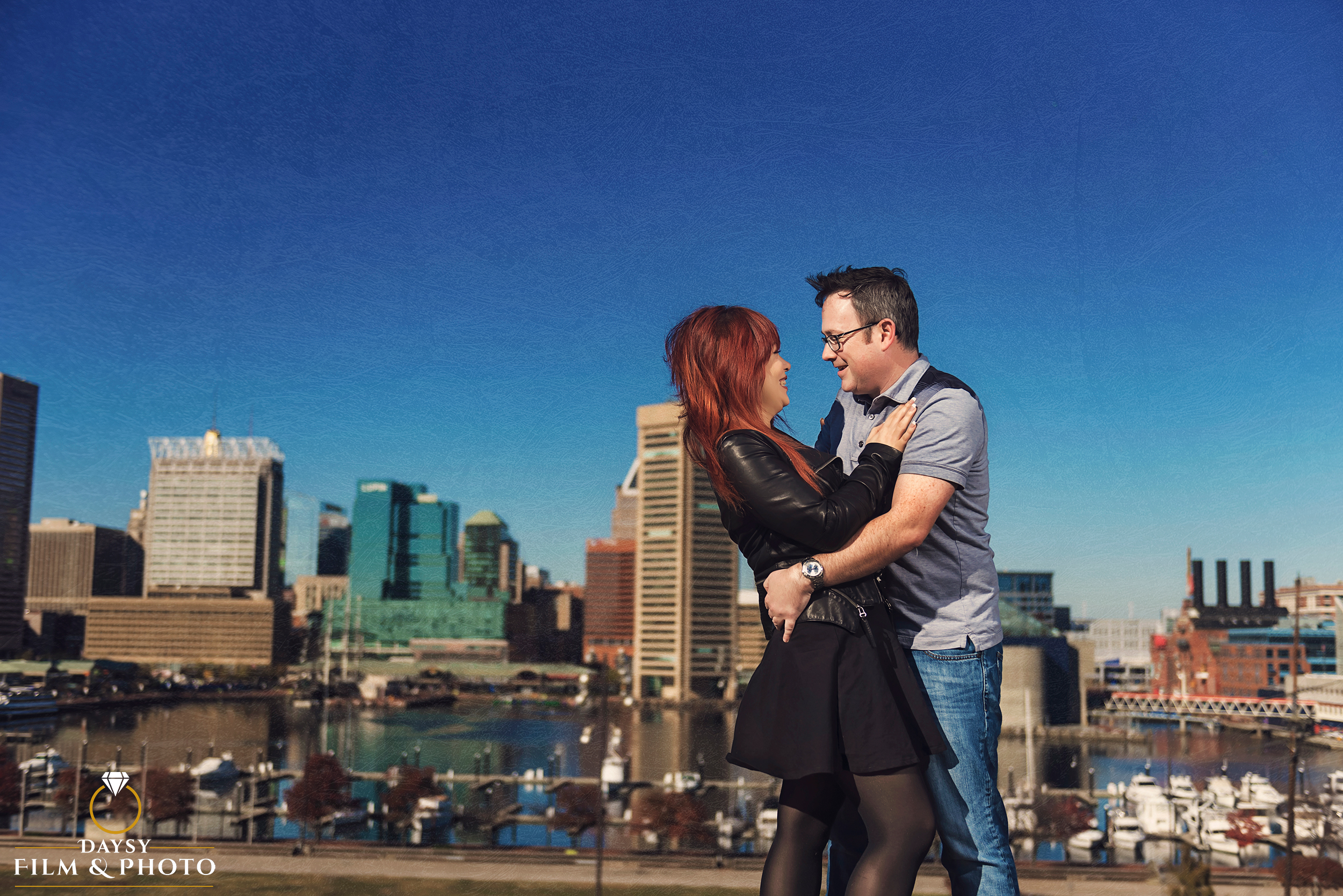 baltimore harbor view at federal hill top engagement couple photo