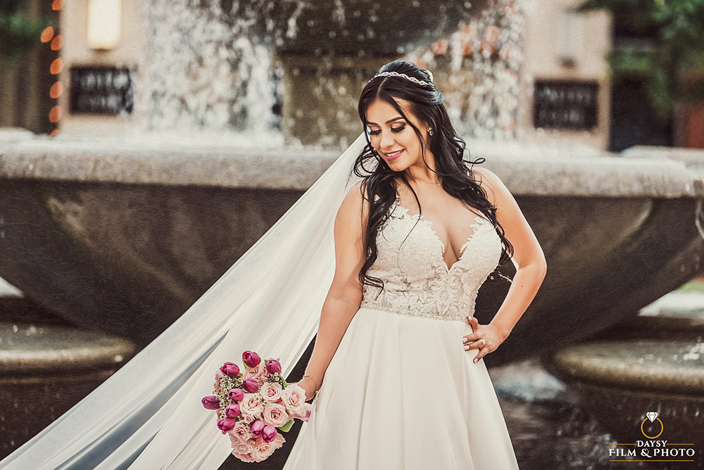 gorgeous bride in front of fountain