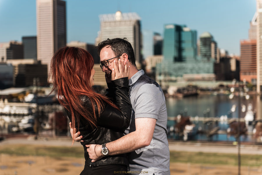 couple standing in front of baltimore downtown at federal hill baltimore