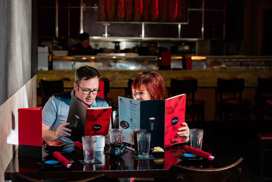 bride and groom picking sushi engagement photos at RA Sushi Bar Restaurant baltimore md