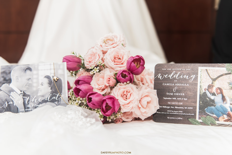 roses and peonies bouquet close up with invites and save the date