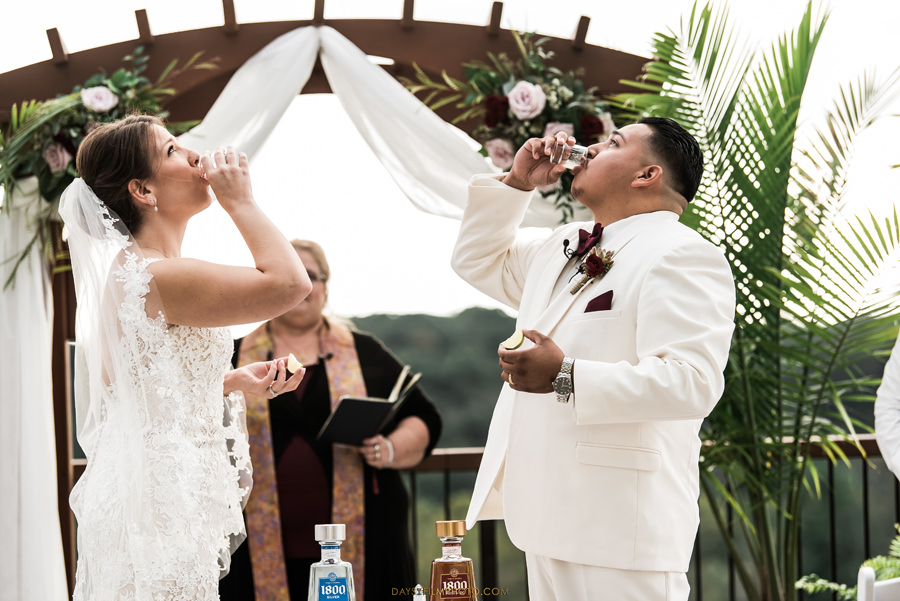 bride and groom doing a tequila shot for ceremony