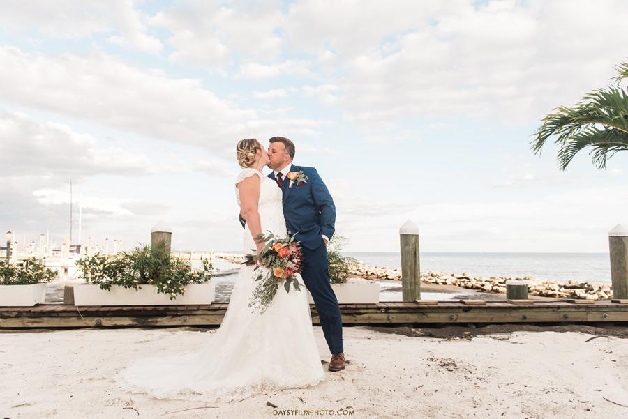 Chesapeake Beach Resort and Spa wedding bride and groom beach behind