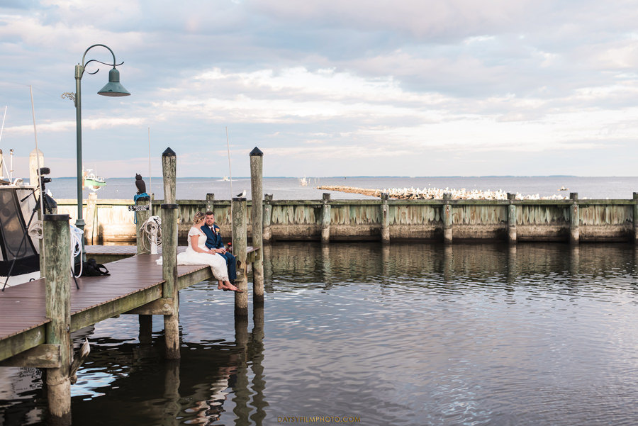 Chesapeake Beach Resort and Spa wedding bride and groom on the pier drinking beer