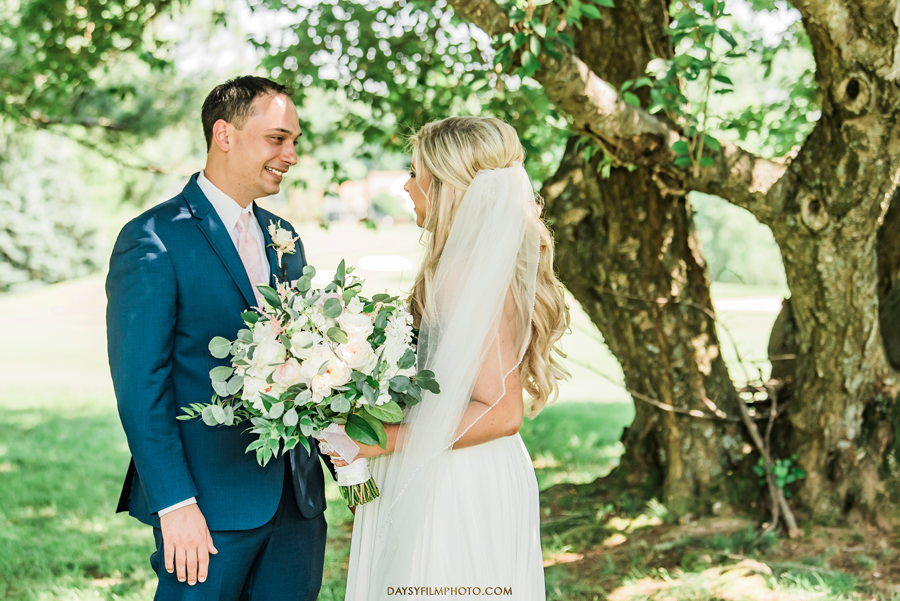 Manor Country Club Spring Wedding bride and groom first look