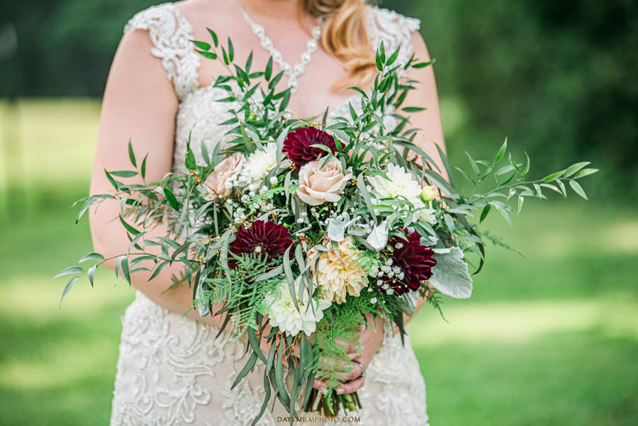 Vineyard of Mary's Meadow bride holding bouquet from Roni's Roses Floral Design