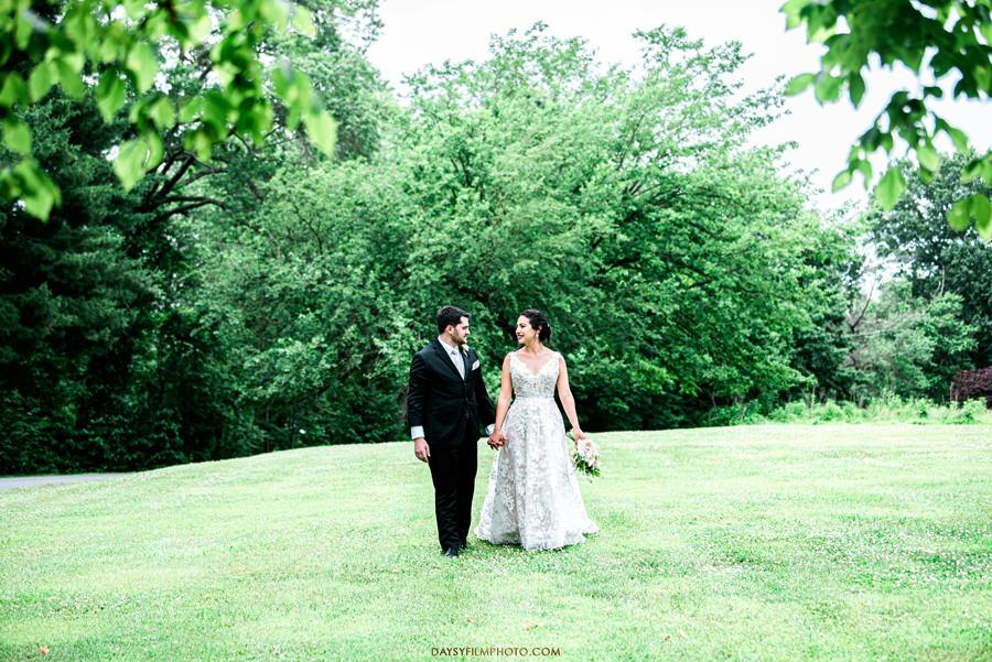 The woodland at algonkian sterling va wedding bride and groom walking