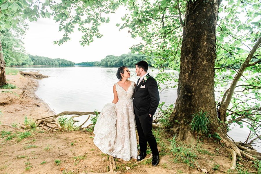 The woodland at algonkian sterling va wedding bride and groom by the river