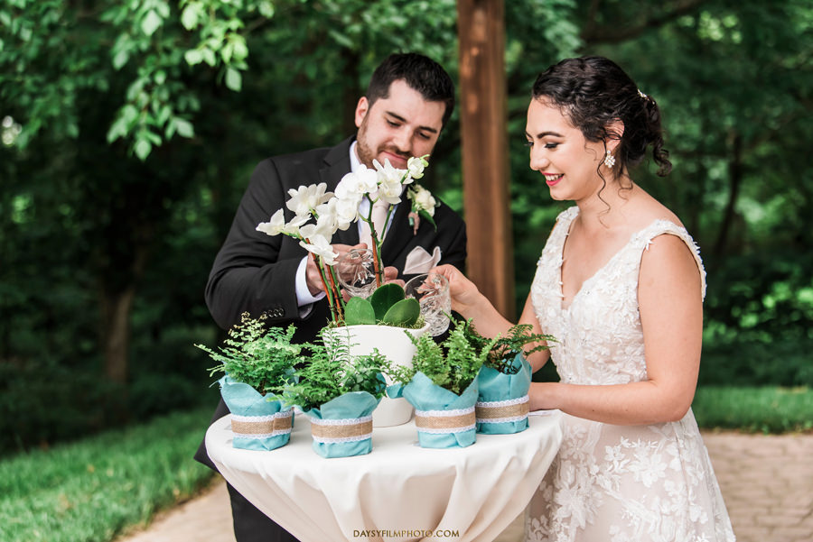 The Woodlands at Algonkian Wedding bride and groom watering the plant