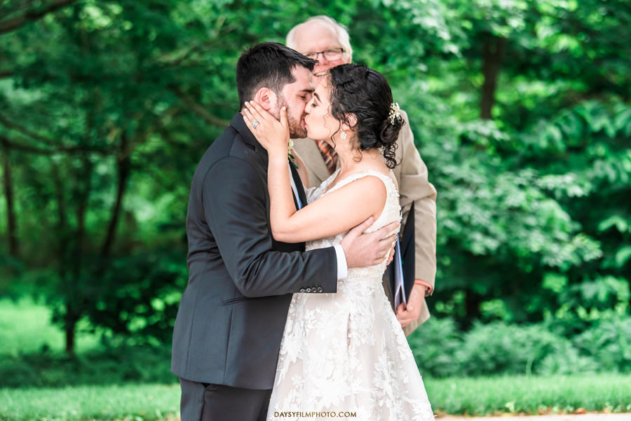 The Woodlands at Algonkian Wedding bride and groom OUTDOOR PERGOLA 1st kiss