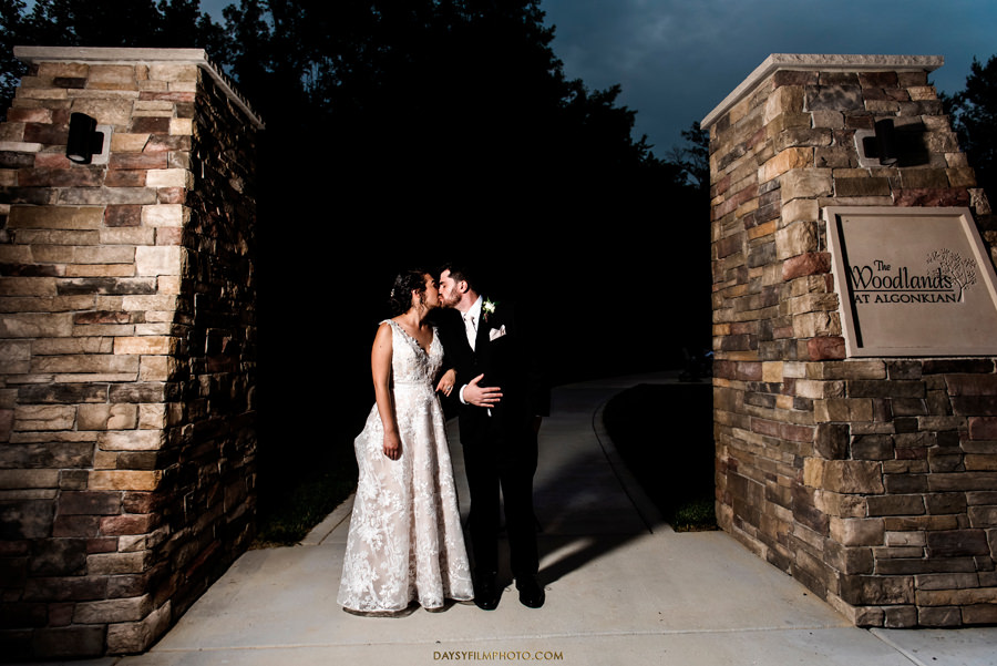 The woodland at algonkian sterling va wedding bride and groom by the sign