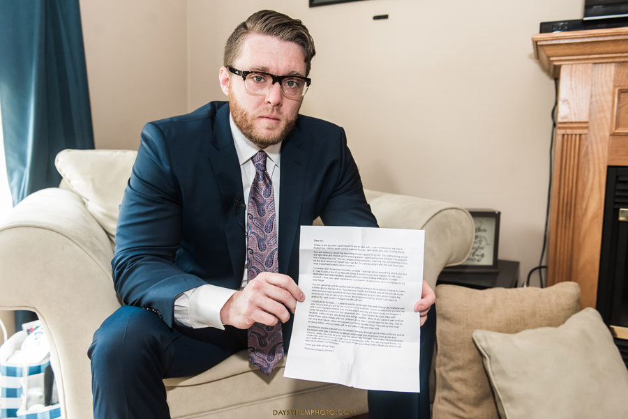 baltimore wedding photos groom reading letter